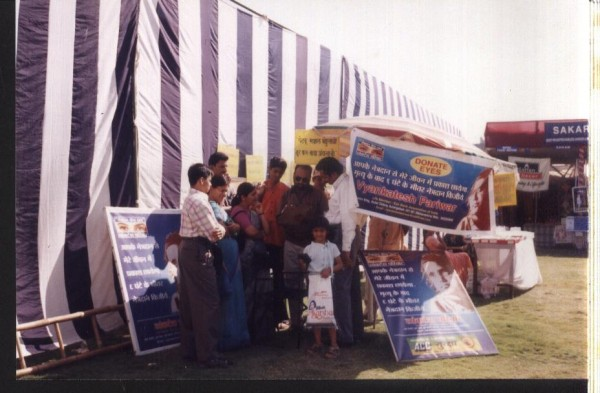 Visitors giving consent for eye donation forms at eye donation stall