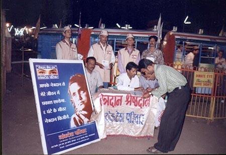 Kishor soni and team members sitting on eye donation registration stall at Anand Nagari