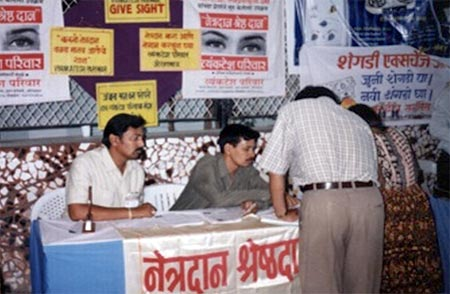Kishor soni and other on eye donation stall,here people sign their consent letters for eye donation
