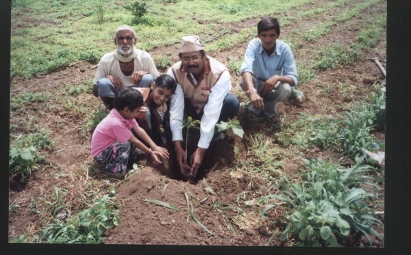 Ad.kishor soni with other members of pariwar planting trees.