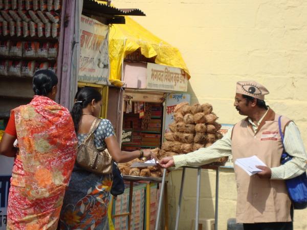 Mr. Kishor Soni distributing eye donation leaflets in Paithan.