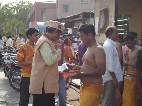 Ad. Kishor Soni, Sandesh Soni, Pratik Kasat distributing leaflets in the temple campus.