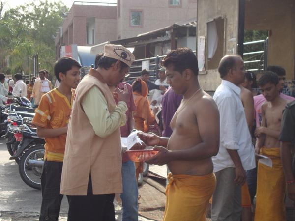 Ad. Kishor Soni, Sandesh Soni, Pratik Kasat distributing leaflets in the temple campus.