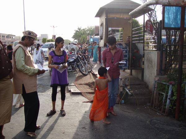 Miss Komal Soni, Pratik Kasat along with Ad. Kishor Soni distributing pamphlets at Shani Shignapur.