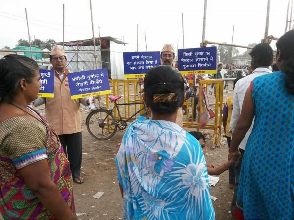 People reading posters of vyankatesh pariwar