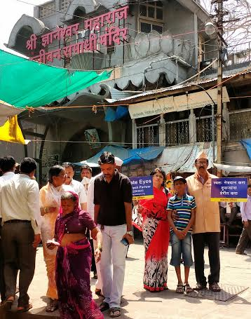 Eye donation motivation to people in front of temple