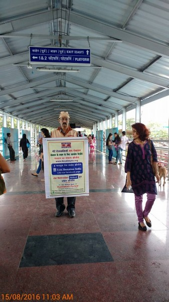 campaign at overbridge on Vileparle railway station