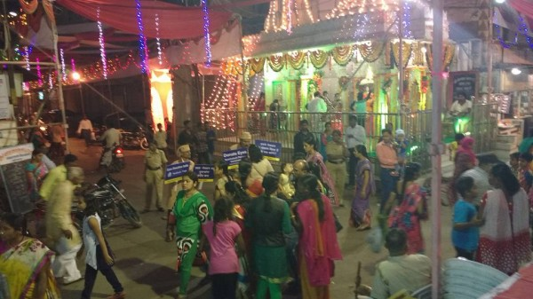 Ladies taking information at Sansthan Ganesh mandal,Rajabazar