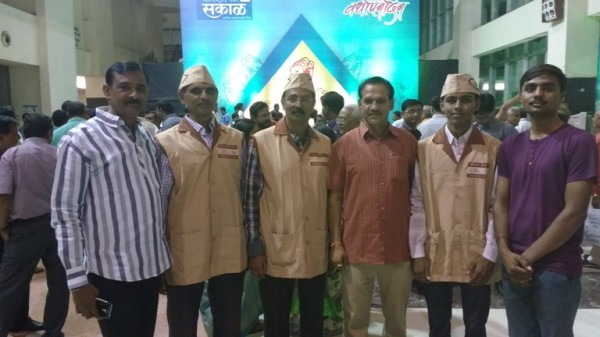 Attending sakal establishment day programme